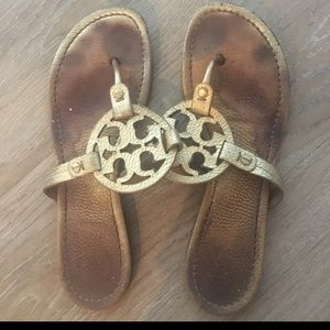 Use Tory Burch sandals.